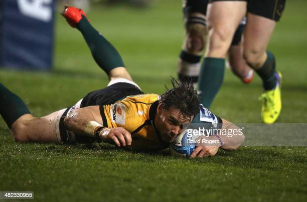 Ben Foden of Northampton dives over for a try during the Amlin Challenge Cup quarter final match between Sale Sharks and Northampton Saints at AJ...