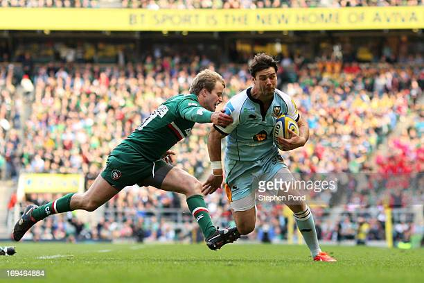 Ben Foden of Northampton goes past Mathew Tait of Leicester to score his team's second try during the Aviva Premiership Final between Leicester...