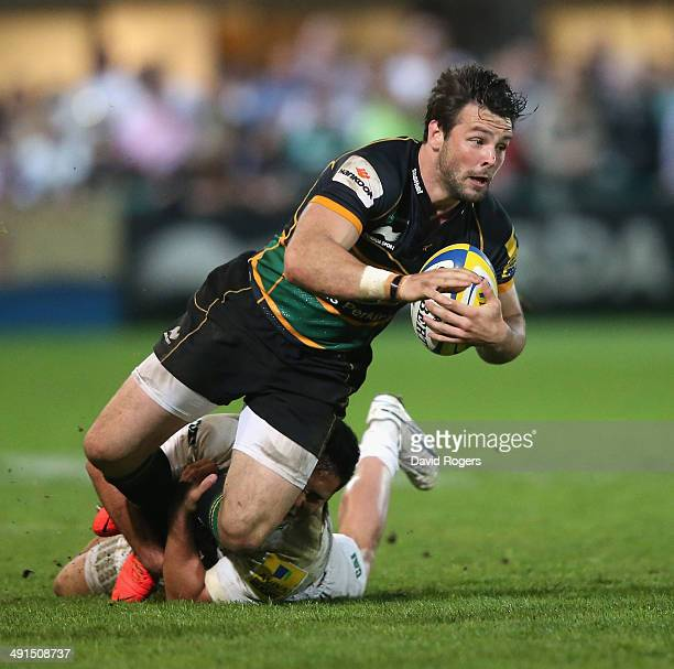 Ben Foden of Northampton is tackled by Dan Bowden during the Aviva Premiership semi final match between Northampton Saints and Leicester Tigers at...