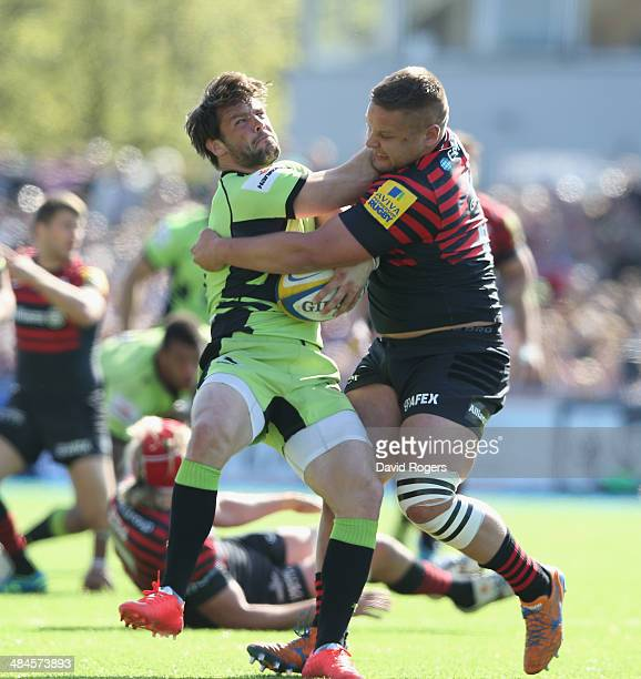 Ben Foden of Northampton is tackled by Richard Barrington during the Aviva Premiership match between Saracens and Northampton Saints at Allianz Park...