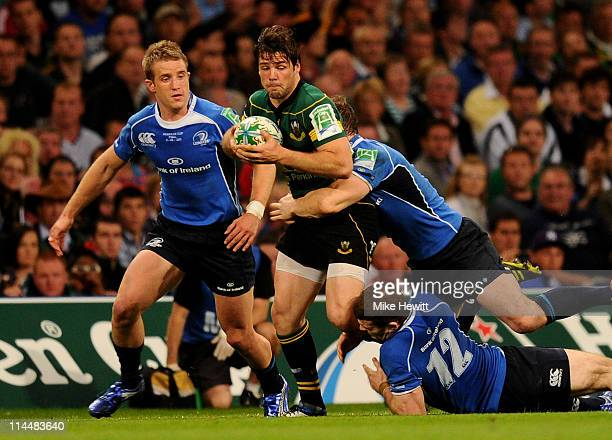 Ben Foden of Northampton is tackled during the Heineken Cup Final match between Leinster and Northampton Saints at the Millennium Stadium on May 21,...