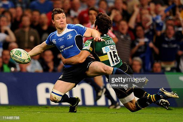 Ben Foden of Northampton makes a try saving tackle on Brian O'Driscoll of Leinster during the Heineken Cup Final match between Leinster and...