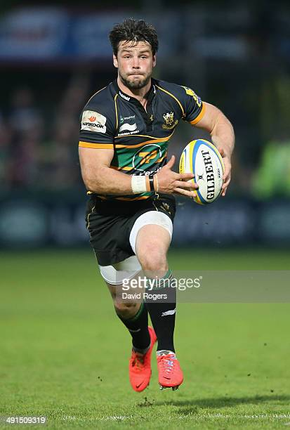 Ben Foden of Northampton runs with the ball during the Aviva Premiership semi final match between Northampton Saints and Leicester Tigers at...
