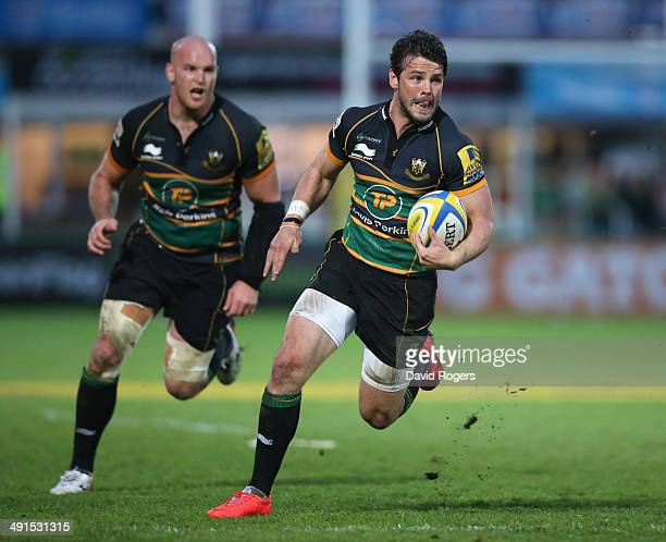 Ben Foden of Northampton runs with the ball with Sam Dickinson in support during the Aviva Premiership semi final match between Northampton Saints...