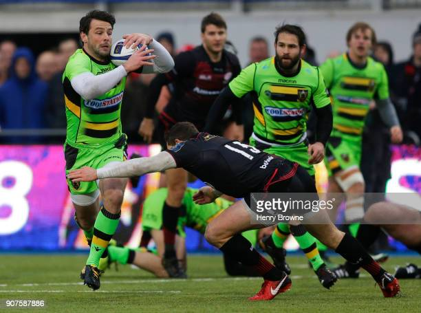 Ben Foden of Northampton Saints and Alex Goode of Saracens during the European Rugby Champions Cup match between Saracens and Northampton Saints at...