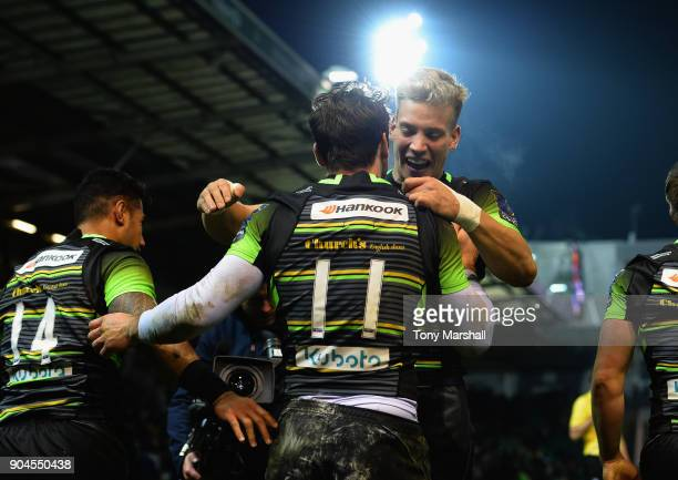 Ben Foden of Northampton Saints celebrates scoring a try with Harry Mallinder during the European Rugby Champions Cup match between Northampton...