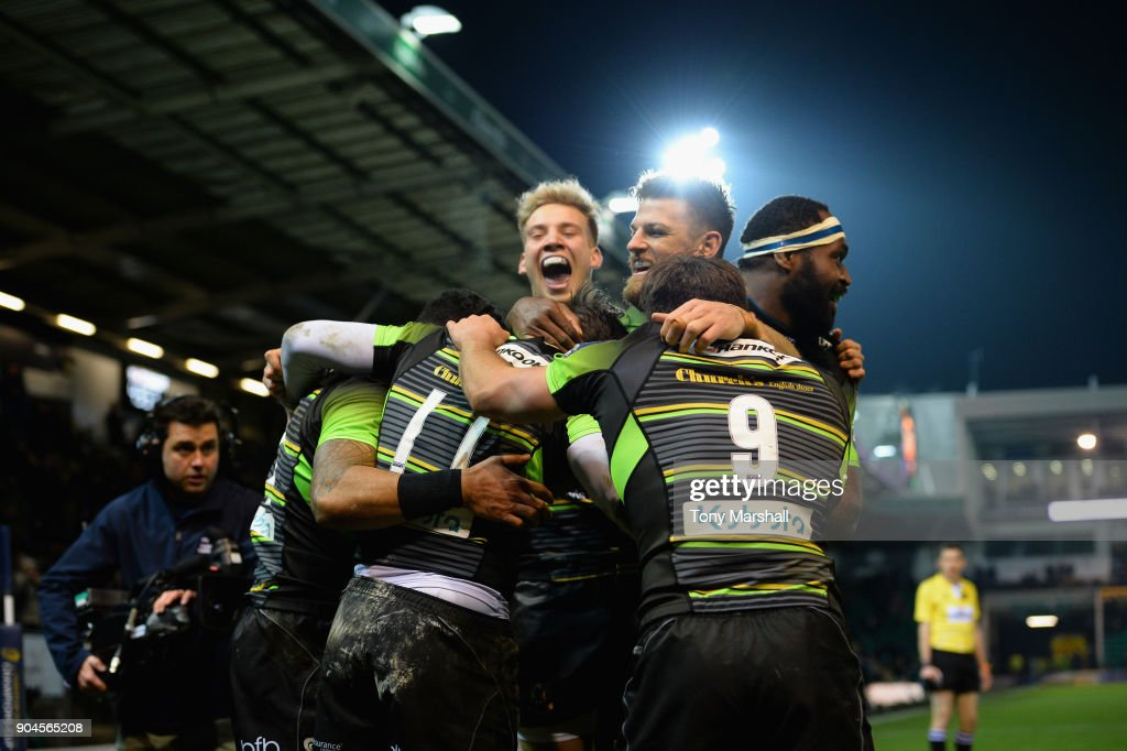 Ben Foden of Northampton Saints (11) celebrates scoring a try with his team mates during the European Rugby Champions Cup match between Northampton Saints and ASM Clermont Auvergne at Franklin's Gardens on January 13, 2018 in Northampton, England.