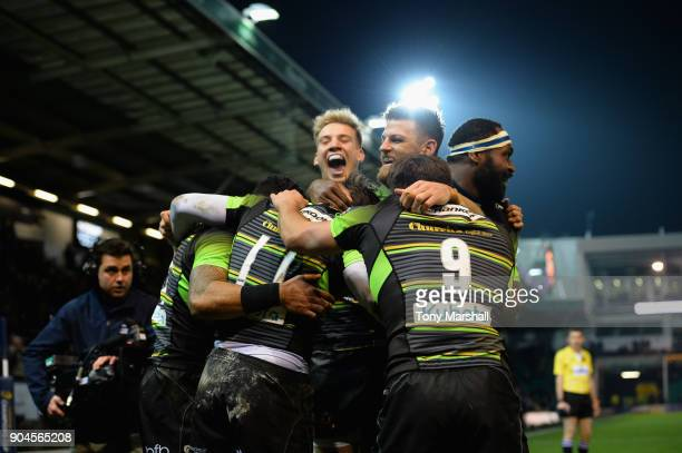 Ben Foden of Northampton Saints celebrates scoring a try with his team mates during the European Rugby Champions Cup match between Northampton Saints...
