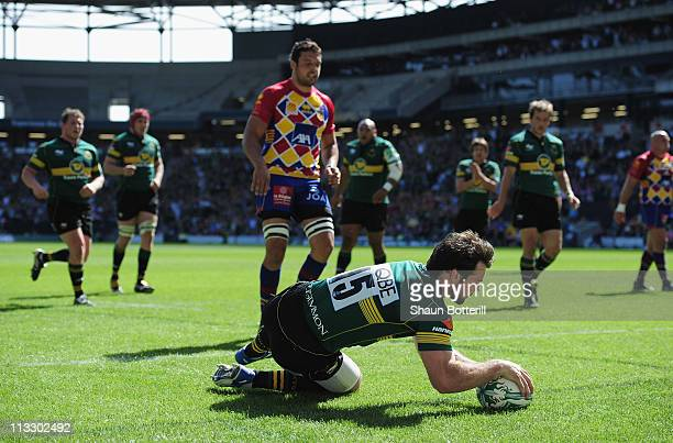 Ben Foden of Northampton Saints crosses the line to score during the Heineken Cup Semi-Final match between Northampton Saints and USA Perpignan at...