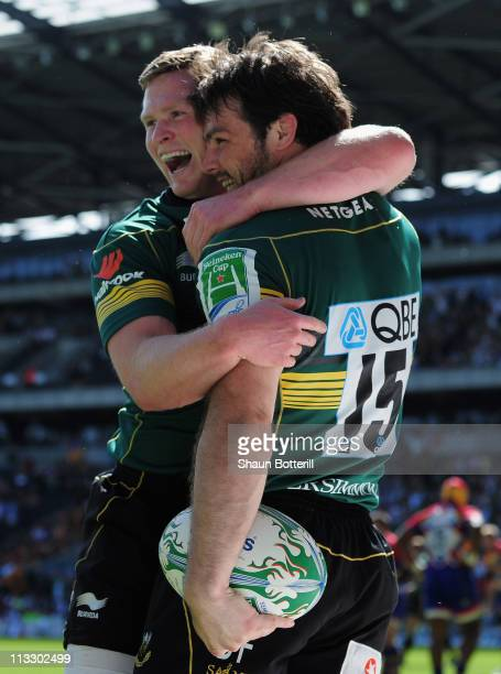 Ben Foden of Northampton Saints is congratulated by teammate Chris Ashton after scoring a try during the Heineken Cup SemiFinal match between...