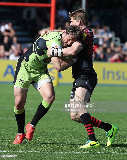 Ben Foden of Northampton Saints is tackled by David Strettle of Saracens during the Aviva Premiership match between Saracens and Northampton Saints...