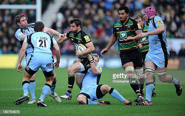 Ben Foden of Saints is tackled by Alex Tait of Falcons during the AVIVA Premiership match between Northampton Saints and Newcastle Falcons at...