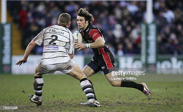 Ben Foden of Sale battles with Barry Williams of Ospreys during the Heineken Cup Round Four match between Sale Sharks and Neath Swansea Ospreys at...