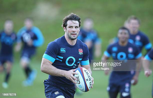 Ben Foden runs with the ball during the England training session held at Pennyhill Park on November 4 2013 in Bagshot England