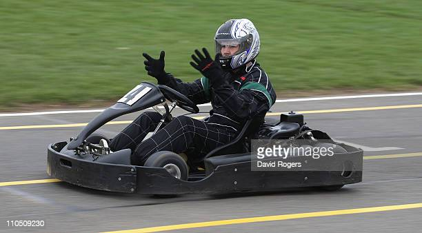 Ben Foden the Northampton Saints and England fullback drives a gokart during the Northampton Saints activity day on March 21 2011 in Northampton...