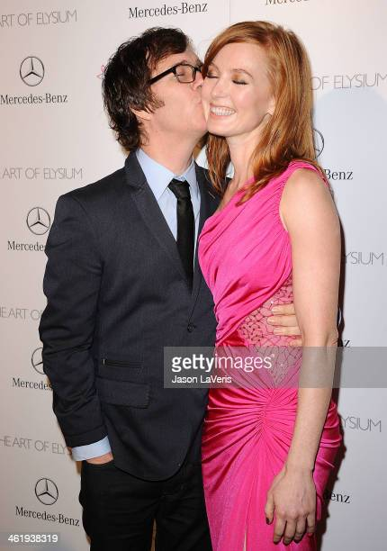 Ben Folds and Alicia Witt attend the Art of Elysium's 7th annual Heavan gala at Skirball Cultural Center on January 11 2014 in Los Angeles California
