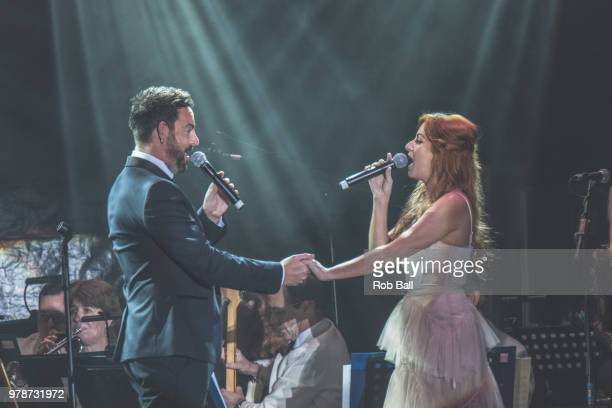 Ben Forster and Celia Graham perform during Andrew Lloyd Webber A Musical Celebration as part of his 70th Birthday celebration at The Royal Hospital...