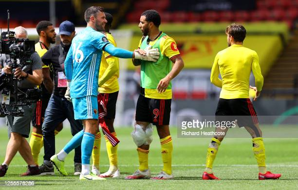 Ben Foster and Troy Deeney of Watford celebrate their team's victory following the Premier League match between Watford FC and Newcastle United at...