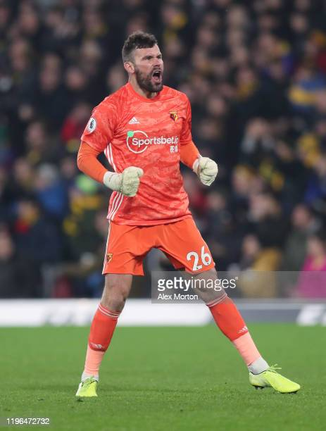 Ben Foster fo Watford celebrates after Troy Deeney scores their second goal during the Premier League match between Watford FC and Aston Villa at...