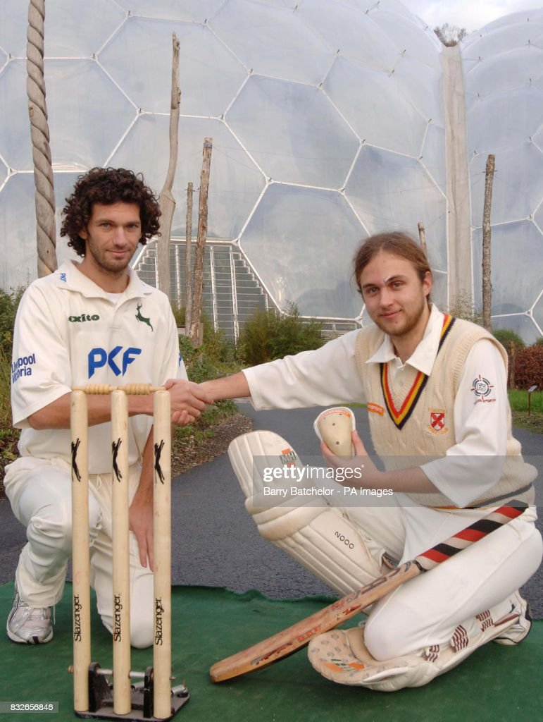 Ben Foster (right) holds up the World's first eco-friendly cricket box, which he designed, and shakes hands with Nottinghamshire Cricket Club bowler Charlie Shreck (left) following a product test for the cricket box, at the Eden project in Cornwall.