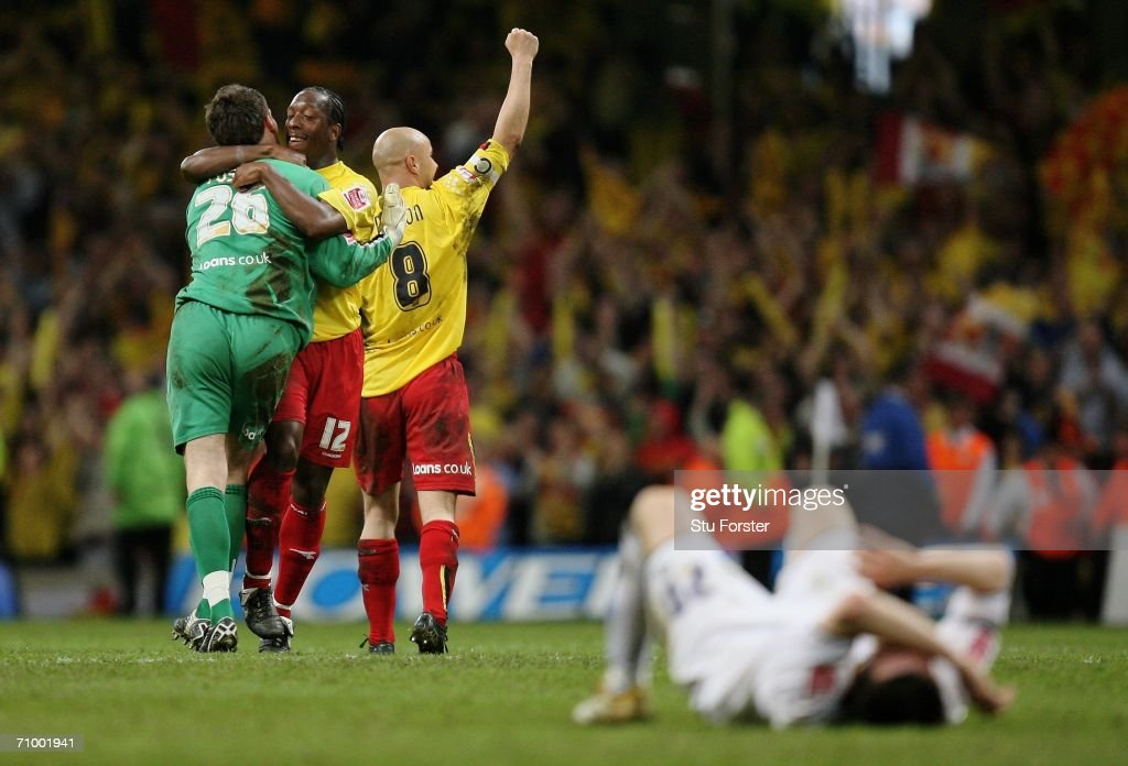 Ben Foster, Lloyd Doyley and Gavin Mahon of Watford celebrate as the final whistle blows, whilst Jonathan Douglas of Leeds lays dejected on the pitch following the Coca-Cola Championship Playoff Final between Leeds United and Watford at the Millennium Stadium on May 21, 2006 in Cardiff, Wales.