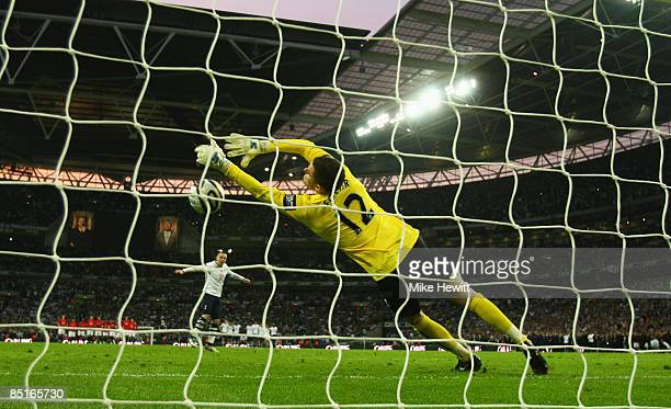 Ben Foster of Manchester saves a penalty from Jamie O'Hara of Tottenham Hotspur in the shoot out during the Carling Cup Final match between...