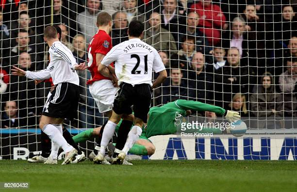 Ben Foster of Manchester saves during the Barclays Premier League match between Derby County and Manchester United at Pride Park on March 15 2008 in...