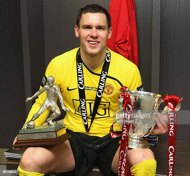 Ben Foster of Manchester United poses in the dressing room with the Carling Cup trophy after the Carling Cup Final match between Manchester United...