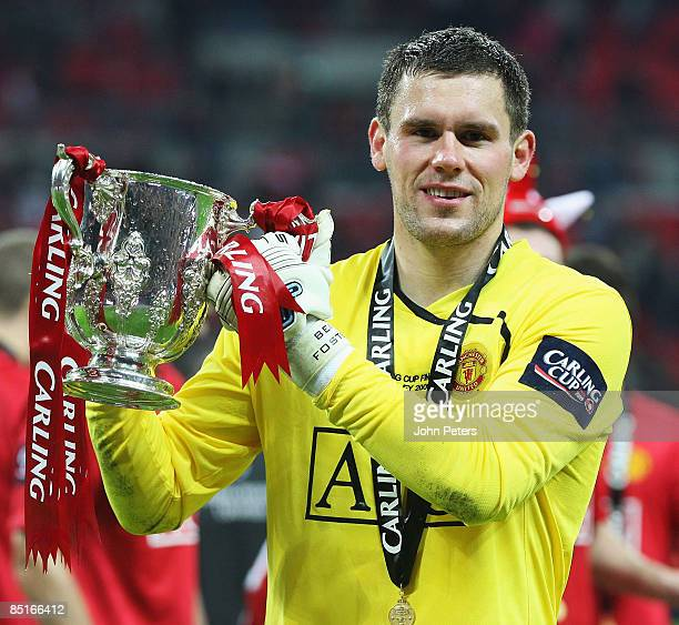 Ben Foster of Manchester United poses with the Carling Cup trophy after the Carling Cup Final match between Manchester United and Tottenham Hotspur...