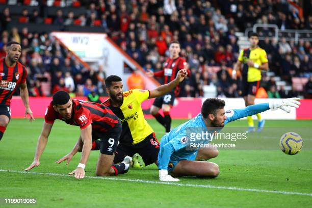 Ben Foster of Watford and Adrian Mariappa of Watford clash with Dominic Solanke of AFC Bournemouth during the Premier League match between AFC...