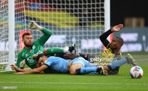 Ben Foster of Watford and Christian Kabasele of Watford collide with Maxime Biamou of Coventry City during the Sky Bet Championship match between...