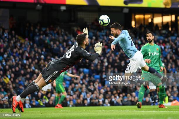 Ben Foster of Watford and David Silva of Manchester City stretch for the ball during the Premier League match between Manchester City and Watford FC...