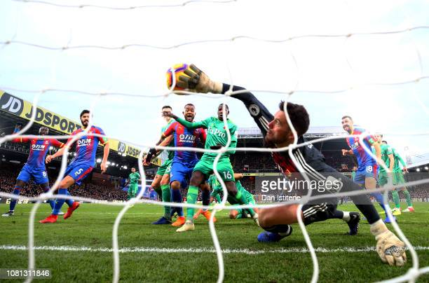 Ben Foster of Watford attempts to clear the ball as Crystal Palace score their first goal during the Premier League match between Crystal Palace and...
