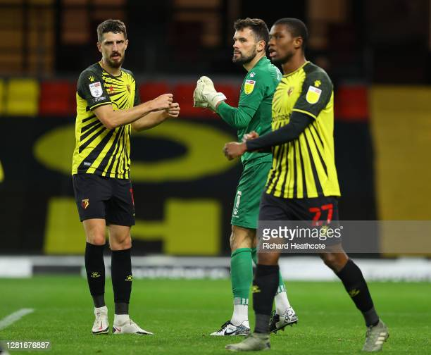 Ben Foster of Watford celebrates with Craig Cathcart after saving a penalty during the Sky Bet Championship match between Watford and Blackburn...