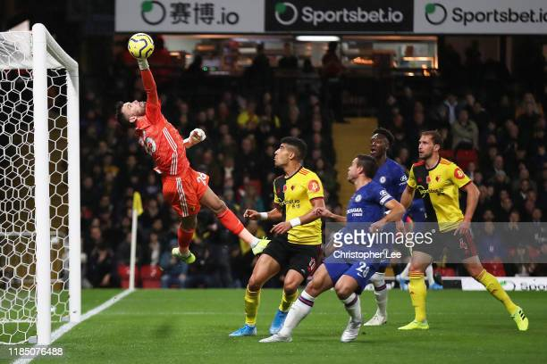 Ben Foster of Watford dives to make a save during the Premier League match between Watford FC and Chelsea FC at Vicarage Road on November 02, 2019 in...