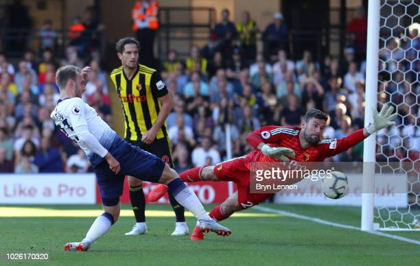 Ben Foster of Watford fails to stop an own goal by Abdoulaye Doucoure of Watford as Christian Eriksen of Tottenham Hotspur stretches for the ball for...