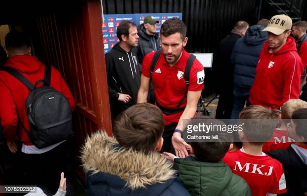 Ben Foster of Watford greets fans as he arrives prior to the FA Cup Third Round match between Woking and Watford at Kingfield Stadium on January 6...