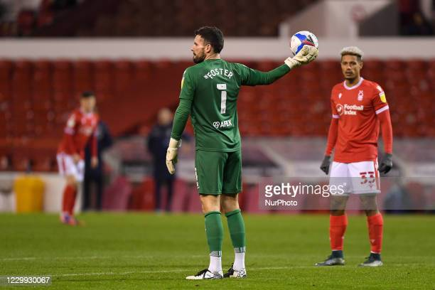 Ben Foster of Watford holds the ball with Lyle Taylor of Nottingham Forest looking on during the Sky Bet Championship match between Nottingham Forest...
