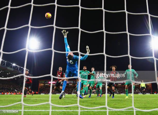 Ben Foster of Watford makes a save from Joshua King of AFC Bournemouth during the Premier League match between AFC Bournemouth and Watford FC at...