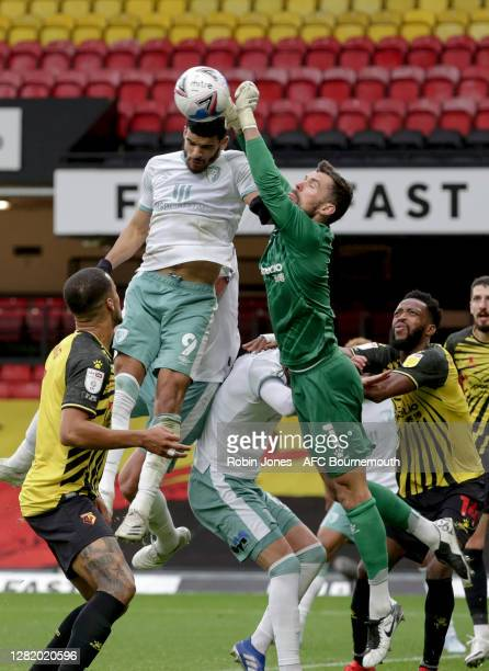 Ben Foster of Watford punches clear from Dominic Solanke of Bournemouth during the Sky Bet Championship match between Watford and AFC Bournemouth at...