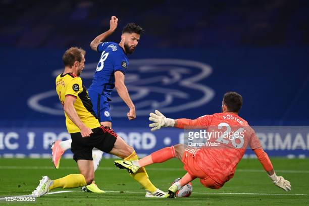 Ben Foster of Watford saves from Olivier Giroud of Chelsea as he is challenged by Craig Dawson of Watford during the Premier League match between...