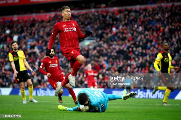 Ben Foster of Watford saves from Roberto Firmino of Liverpool during the Premier League match between Liverpool FC and Watford FC at Anfield on...