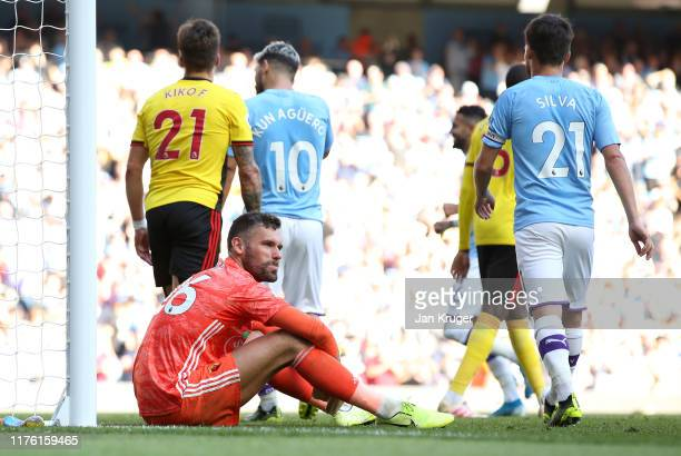 Ben Foster of Watford sits on the ground dejected during the Premier League match between Manchester City and Watford FC at Etihad Stadium on...