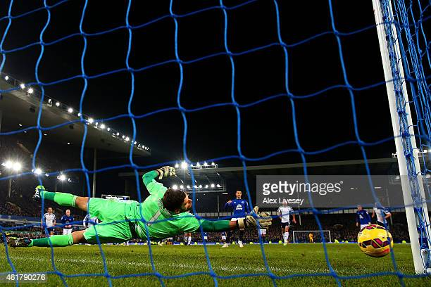Ben Foster of West Brom dives as Kevin Mirallas of Everton fails to score from the penalty spot during the Barclays Premier League match between...