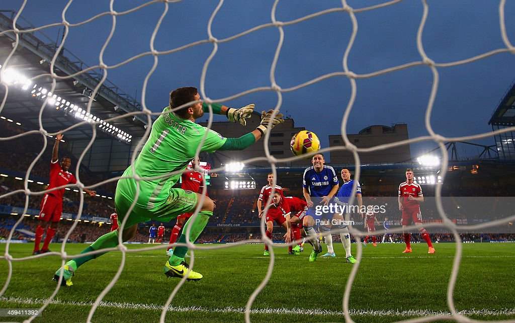 Ben Foster of West Brom makes a save from John Terry of Chelsea header during the Barclays Premier League match between Chelsea and West Bromwich Albion at Stamford Bridge on November 22, 2014 in London, England.