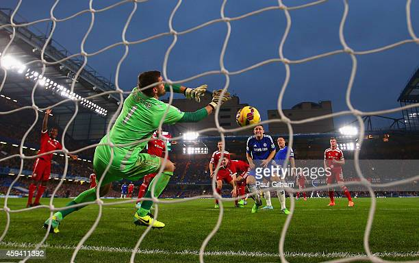 Ben Foster of West Brom makes a save from John Terry of Chelsea header during the Barclays Premier League match between Chelsea and West Bromwich...