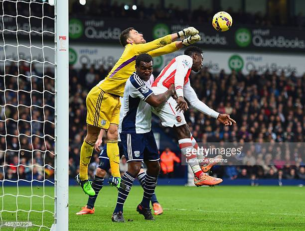 Ben Foster of West Brom punches the ball clear during the Barclays Premier League match between West Bromwich Albion and Arsenal at The Hawthorns on...