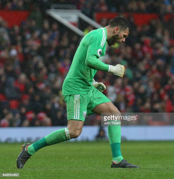 Ben Foster of West Bromwich Albion celebrates Jay Rodriguez scoring their first goal during the Premier League match between Manchester United and...