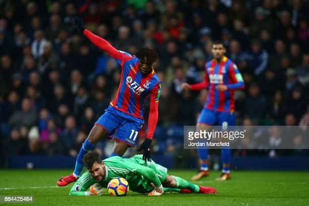 Ben Foster of West Bromwich Albion collects the ball from Wilfried Zaha of Crystal Palace during the Premier League match between West Bromwich...