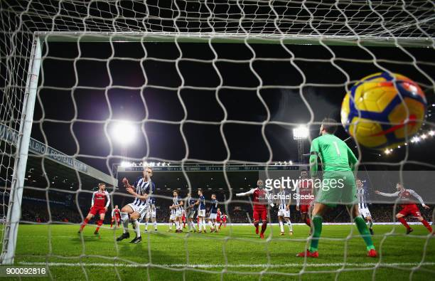 Ben Foster of West Bromwich Albion fails to stop a free kick by Alexis Sanchez of Arsenal which deflects off James McClean of West Bromwich Albion...